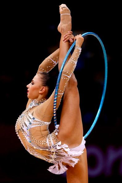 LONDON, ENGLAND - AUGUST 11:  Daria Dmitrieva of Russia competes during the Individual All-Around Rhythmic Gymnastics final on Day 15 of the London 2012 Olympics Games at Wembley Arena on August 11, 2012 in London, England.  (Photo by Jamie Squire/Getty Images)