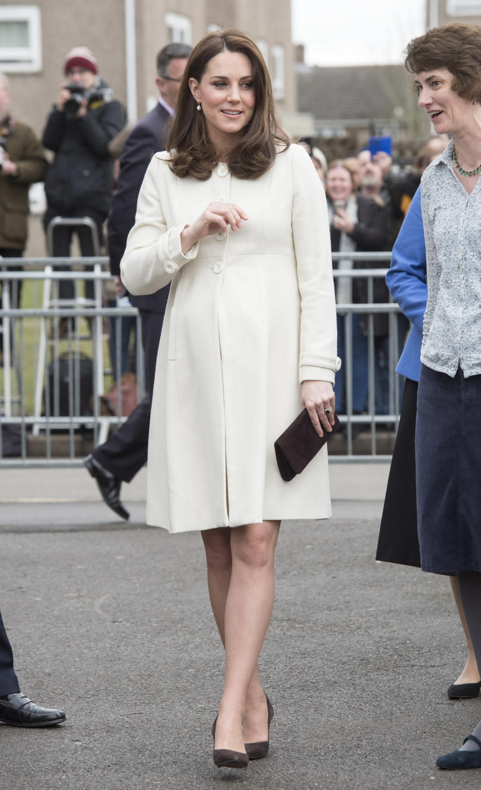 <p>The Duchess looked typically stylish in a £69 cream JoJo Maman Bebe maternity coat, she'd previously worn on a visit to the set of Downton Abbey when she was pregnant wih Princess Charlotte. She kept her accessories simple with classic brown court shoes and a matching clutch.<br><br>The Duchess was visiting Pegasus primary school in Oxford to learn about how the charity Family Links had helped pupils and their families through emotional health and wellbeing issues. [Photo: Getty] </p>