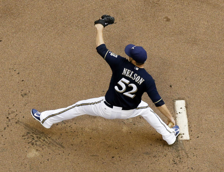 Milwaukee Brewers starting pitcher Jimmy Nelson throws during the first inning of a baseball game against the Toronto Blue Jays Wednesday, Aug. 20, 2014, in Milwaukee. (AP Photo/Morry Gash)