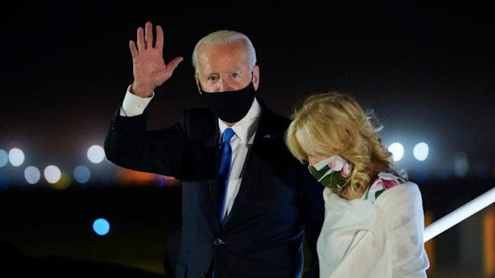 Democratic presidential nominee Joe Biden and his wife. Dr. Jill Biden, exit his campaign plane in New Castle, Delaware, <br>returning from Nashville, Tennessee and the former vice president's final debate with President Donald Trump. <br>(Photo by Drew Angerer/Getty Images)