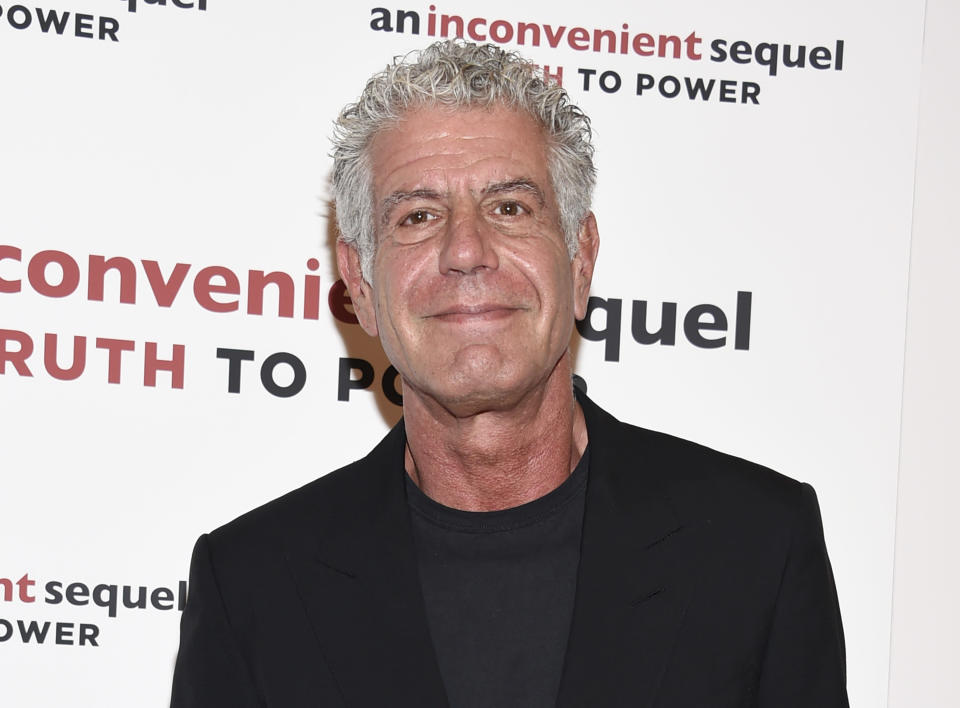 """FILE - In this Monday, July 17, 2017, file photo, television personality Anthony Bourdain attends a special screening of """"An Inconvenient Sequel: Truth To Power"""" at The Whitby Hotel in New York. The revelation that a documentary filmmaker used voice-cloning software to make the late chef Bourdain say words he never spoke has drawn criticism amid ethical concerns about use of the powerful technology. The movie """"Roadrunner: A Film About Anthony Bourdain"""" appeared in cinemas Friday, July 16, 2021, and mostly features real footage of the beloved celebrity chef and globe-trotting television host before he died in 2018. (Photo by Evan Agostini/Invision/AP, File)"""
