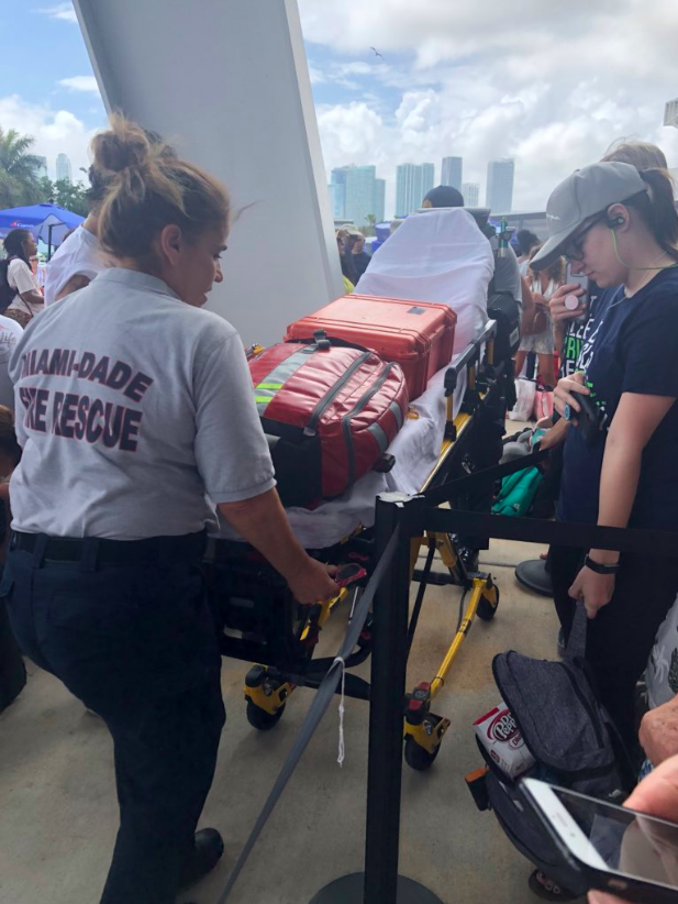 Emergency medical workers showed up with stretchers for provide relief to passengers getting ill while waiting to board the Carnival Magic. (Photo: Courtesy of Twitter/Tracey Wiseheart)