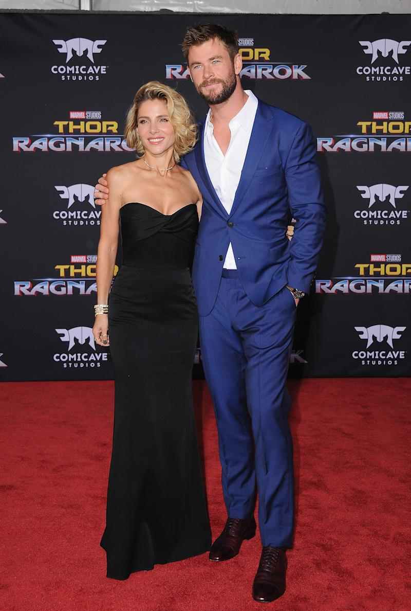 "Elsa Pataky and Chris Hemsworth walk the red carpet at ""Thor: Ragnarok"" premiere.  (Jon Kopaloff via Getty Images)"