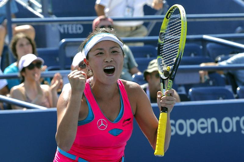 Peng Shuai of China celebrates after defeating Agnieszka Radwanska of Poland during the 2014 US Open women's singles match on August 27, 2014 in New York