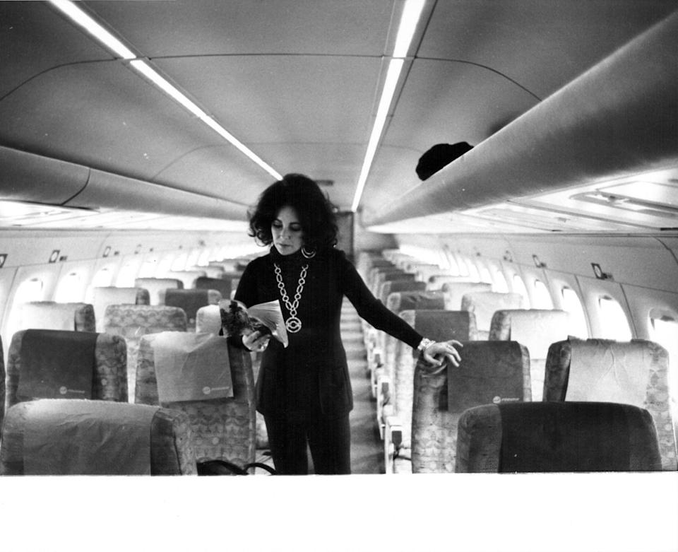 <p>Elizabeth Taylor on her personal plane in the '70s. </p>