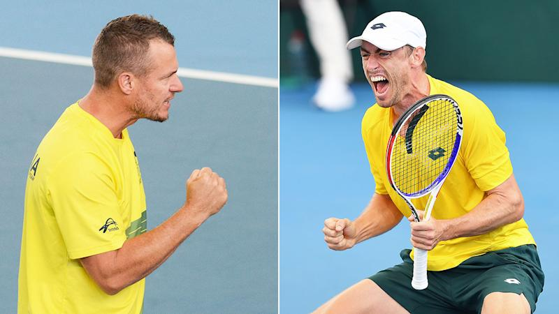Pictured on the left, Australia captain Lleyton Hewitt cheers on John Millman during the Davis Cup tie against Brazil.