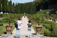 Visitors take photos of the gardens of the Papal Palace in Castel Gandolfo, some 30 kilometers southeast of Rome, Saturday, May 29, 2021. As Covid-19 restrictions are slowly being lifted in Italy, thousands of people are returning to visit the extensive gardens and apartments at the Papal Palace of Castel Gandolfo in the Alban Hills near Rome, that for hundreds of years have been the summer retreat for Popes seeking to escape the suffocating heat of Rome. (AP Photo/Andrew Medichini)