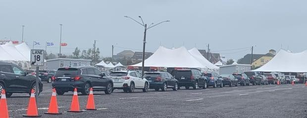 Vehicles were streaming off the Confederation Bridge onto the islandSaturday for the Labour Day weekend despite wind and rain. (Tony Davis/CBC - image credit)