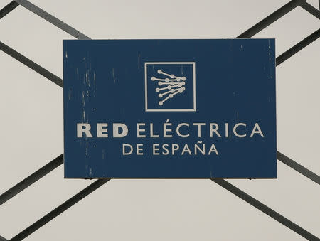 FILE PHOTO: The logo of Spanish electricity grid operator Red Electrica ca Espa–a is attached in a electricity pylon in Alcobendas, outside Madrid, Spain, March 9, 2016. REUTERS/Sergio Perez