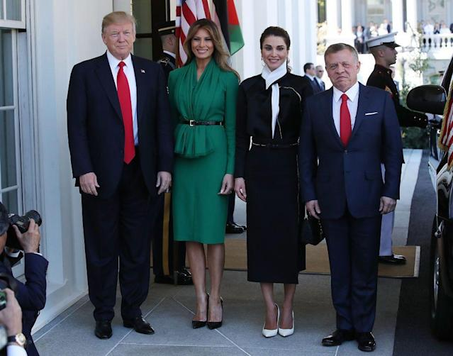 <p>To greet King Abdullah II of Jordan and his wife Queen Rania, Melania wore a jade belted Herve Pierre dress with a gathered front and slit skirt. She finished the outfit with a pair of black snake-print heels by Christian Louboutin, a known favorite of hers.</p>