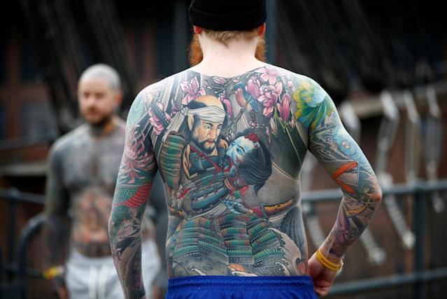 <p>Visitors to the London Tattoo Convention show off their body tattoos, in London, Britain, Sept. 23, 2017. (Photo: Peter Nicholls/Reuters) </p>