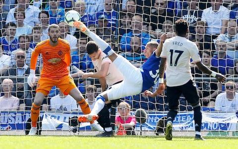 Everton's Richarlison scores their first goal - Credit: Reuters