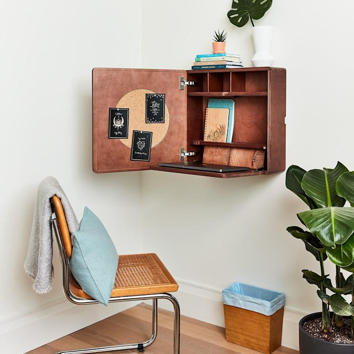 Don't have enough space to commit a full room to a home office? Consider one of these snazzy foldable secretary desks for your wall!