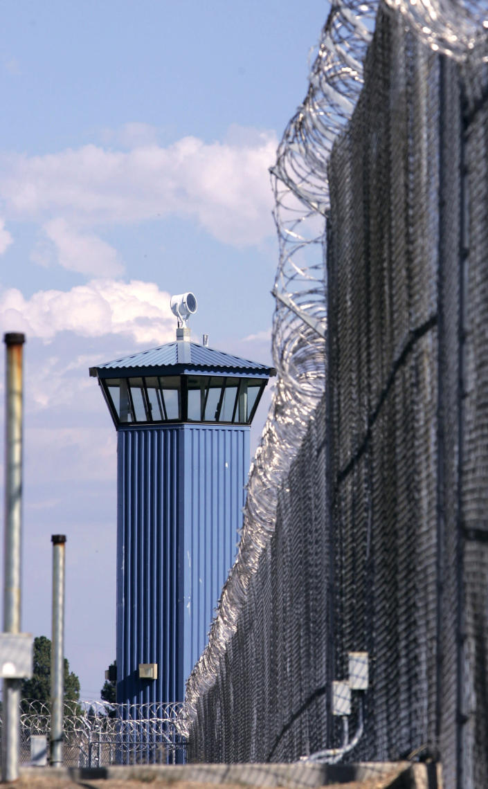 FILE - In this Aug. 31, 2007, file photo, a guard tower is seen behind the wire fence that surrounds California State Prison, Sacramento, in Folsom, Calif. The California prison guard Sgt. Kevin Steele, 56, killed himself after reporting corruption and harassment at the prison to authorities and cooperating with attorneys suing the state according to the Sacramento Bee, Wednesday, Oct. 6, 2021. (AP Photo/Rich Pedroncelli, File)