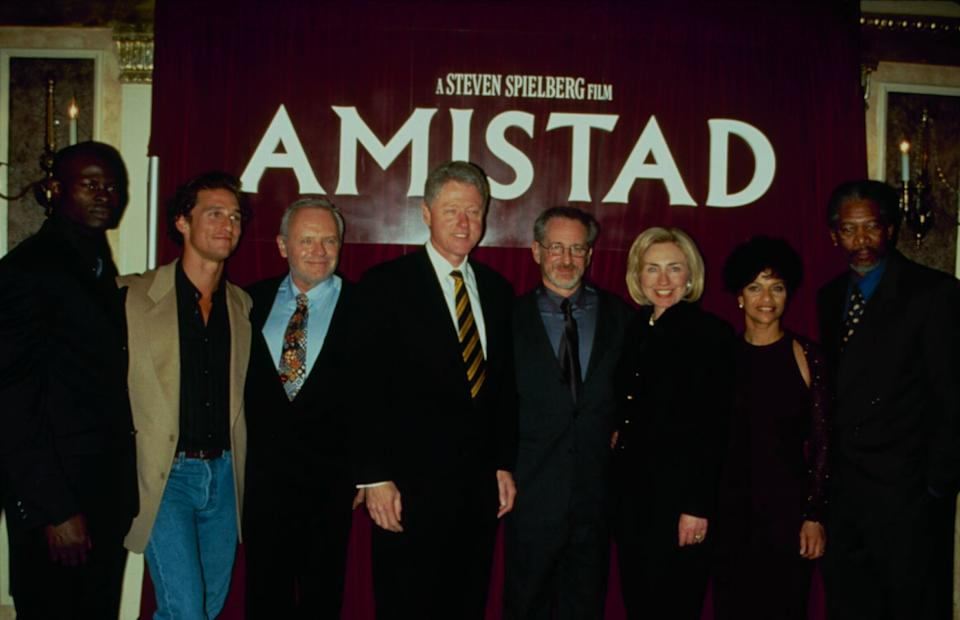 """Djimon Hounsou, Matthew McConaughey, Anthony Hopkins, Bill Clinton, Steven Spielberg, Hillary Clinton, Allen and Morgan Freeman at an """"Amistad"""" screening in 1997. (Photo: Time & Life Pictures via Getty Images)"""