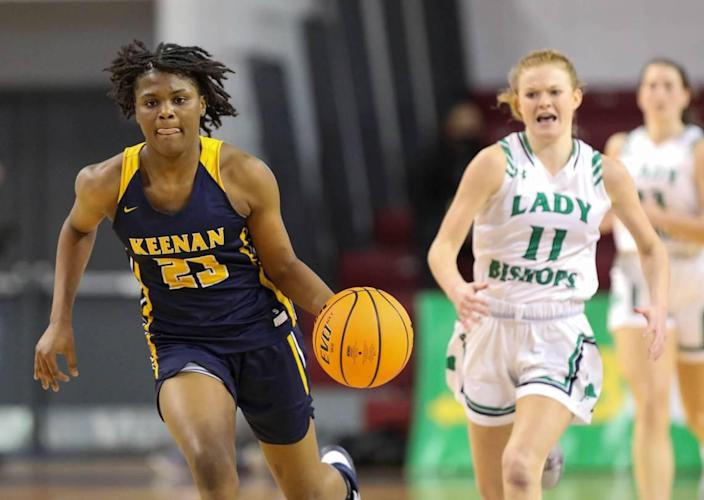Keenan's MiLaysia Fulwiley (23) dribbles downcourt as with Bishop England's Alli Dominiak in pursuit during the 3A state championship game at the USC Aiken Convocation Center on Friday, March 5, 2021.