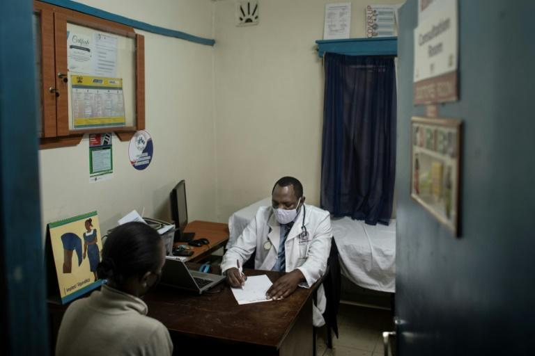 Dozens of women visit Samson Otiago's Nairobi clinic every month and most have to be coaxed into telling him about their intention to terminate a pregnancy (AFP/Tony KARUMBA)