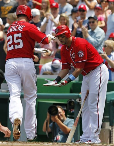 Washington Nationals' Adam LaRoche (25) reacts with upcoming batter Michael Morse after hitting a solo home run during the second inning of a baseball game with the New York Yankees at Nationals Park, Sunday, June 17, 2012, in Washington. (AP Photo/Alex Brandon)