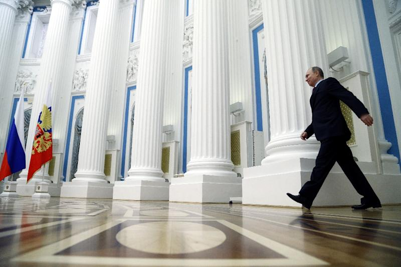 Russian President Vladimir Putin was able to impose himself on 2015's most pressing problems, returning to the diplomatic centre stage over the Syrian conflict (AFP Photo/Maxim Shipenkov)