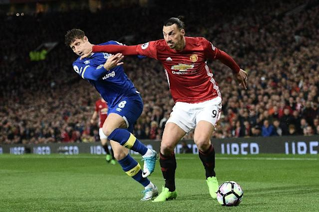 Manchester United's Zlatan Ibrahimovic (R) vies with Everton's Ross Barkley during the English Premier League football match that ended in a 1-1 draw on April 4, 2017 (AFP Photo/Oli SCARFF )