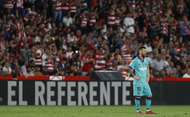 Barcelona's Messi reacts during the Spanish La Liga soccer match between Barcelona and Granada at the Los Carmenes stadium in Granada, Spain, Saturday, Sept. 21, 2019. Ganada won 2-0. (AP Photo/Miguel Morenatti)
