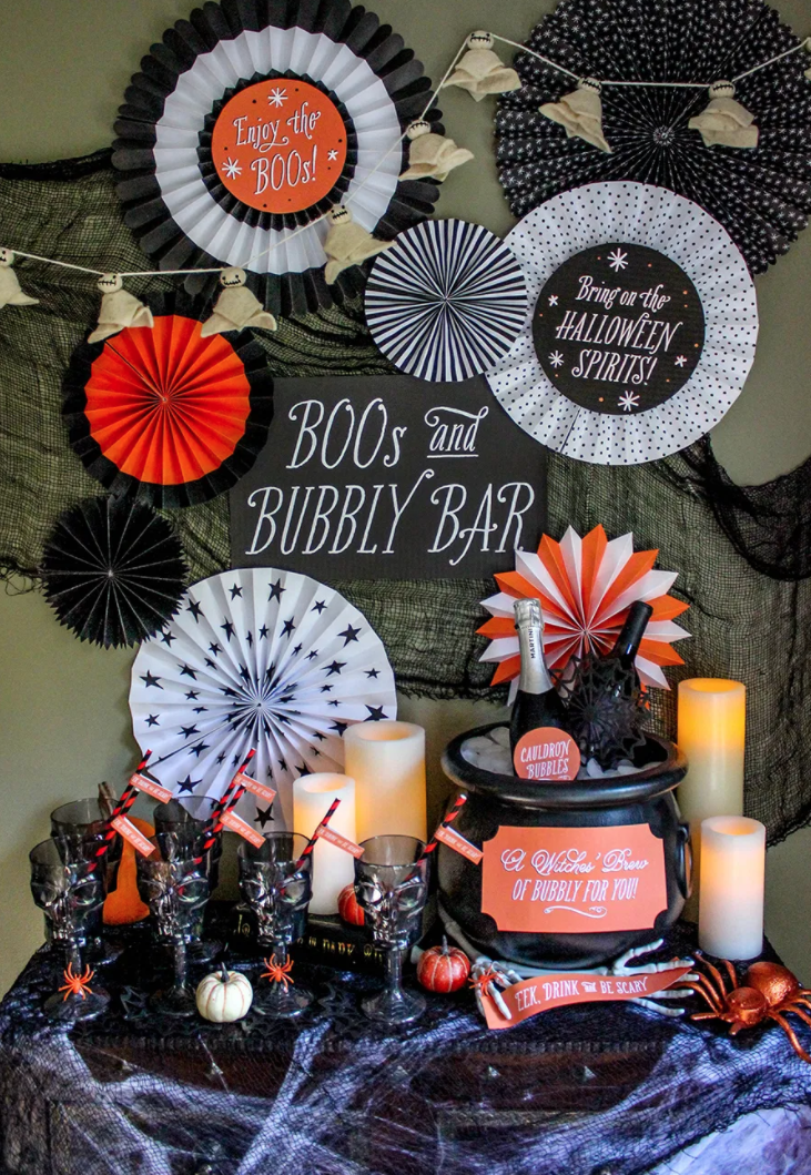 "<p>To easily serve your party guests who are just there for the boos (read: booze!), set up a serve-yourself champagne bar by filling a cauldron with ice and nestling in some of your favorite bottles of bubbly.</p><p><strong>Get the tutorial at <a href=""https://www.justaddconfetti.com/halloween/boos-and-bubbly-bar/"" rel=""nofollow noopener"" target=""_blank"" data-ylk=""slk:Just Add Confetti"" class=""link rapid-noclick-resp"">Just Add Confetti</a>.</strong></p><p><a class=""link rapid-noclick-resp"" href=""https://www.amazon.com/Union-United-Solutions-55160-Cauldron/dp/B01158PC62/ref=sr_1_2?tag=syn-yahoo-20&ascsubtag=%5Bartid%7C10050.g.4620%5Bsrc%7Cyahoo-us"" rel=""nofollow noopener"" target=""_blank"" data-ylk=""slk:SHOP CAULDRONS"">SHOP CAULDRONS</a></p>"