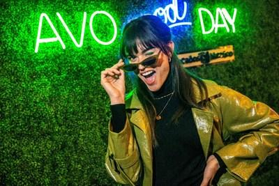 Laurie Bing struck a pose under the lights of the AvoEatery Avo Good Day sign. Credit: Randy Anderson