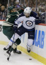 Minnesota Wild center Mikael Granlund, left, of Finland, and Winnipeg Jets center Mathieu Perreault (85) battle for the puck during the second period of an NHL hockey game in St. Paul, Minn., Saturday, Dec. 27, 2014. (AP Photo/Ann Heisenfelt)
