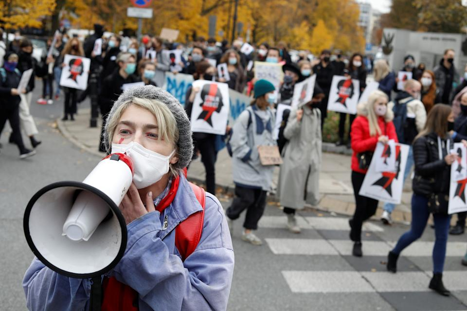 A demonstrator speaks through a megaphone as people protest against the ruling by Poland's Constitutional Tribunal that imposes a near-total ban on abortion, in front of the Parliament in Warsaw, Poland October 27, 2020. Maciek Jazwiecki/Agencja Gazeta via REUTERS ATTENTION EDITORS - THIS IMAGE WAS PROVIDED BY A THIRD PARTY. POLAND OUT. NO COMMERCIAL OR EDITORIAL SALES IN POLAND.