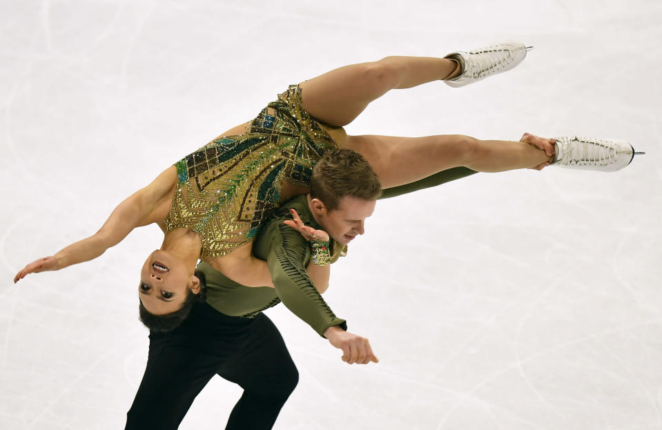 Madison Chock and Evan Bates of the USA perform during the Ice Dance-Free Dance at the Figure Skating World Championships in Stockholm, Sweden, Saturday, March 27, 2021. (AP Photo/Martin Meissner)
