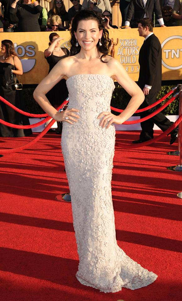 Julianna Margulies (in Calvin Klein Collection) arrives at the 18th Annual Screen Actors Guild Awards at The Shrine Auditorium in Los Angeles, California.