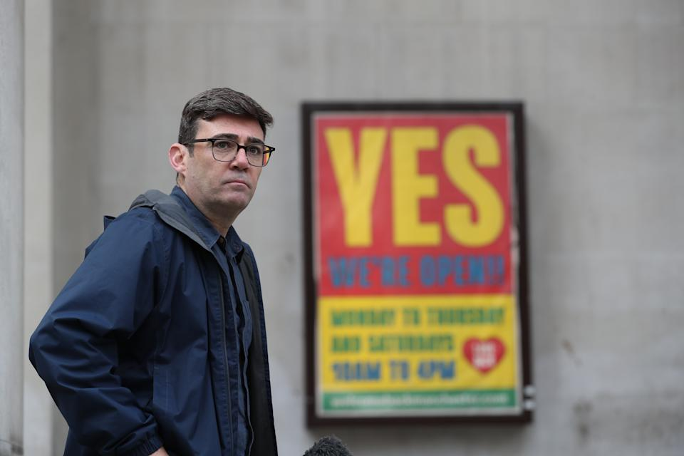 Greater Manchester mayor Andy Burnham speaking to the media outside the Central Library in Manchester, he has threatened legal action if Tier 3 restrictions are imposed without agreement.