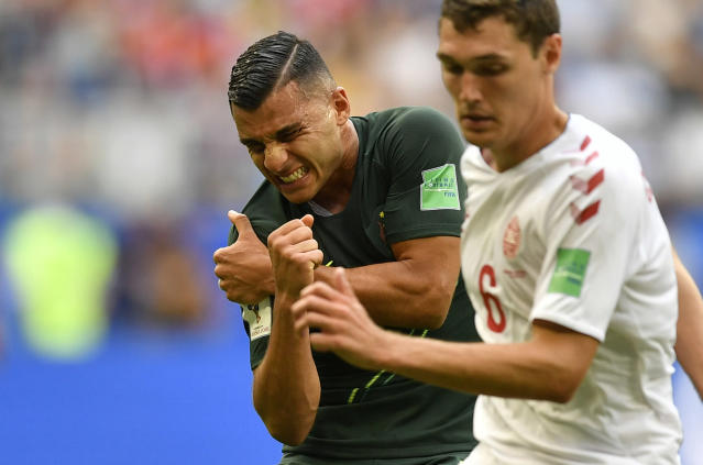 Australia's Andrew Nabbout grimaces in pain after suffering a shoulder injury during the group C match between Denmark and Australia at the 2018 soccer World Cup in the Samara Arena in Samara, Russia, Thursday, June 21, 2018. (AP Photo/Martin Meissner)
