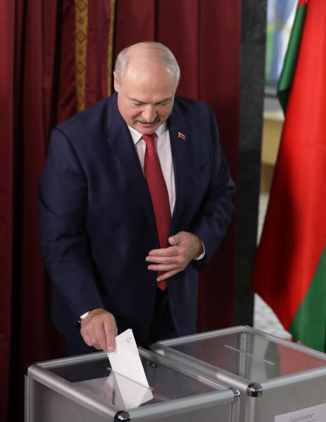 Belarusian President Alexander Lukashenko casts his ballot at a polling station during parliamentary elections, in Minsk, Belarus, Sunday, Nov. 17, 2019. (AP Photo/Sergei Grits)