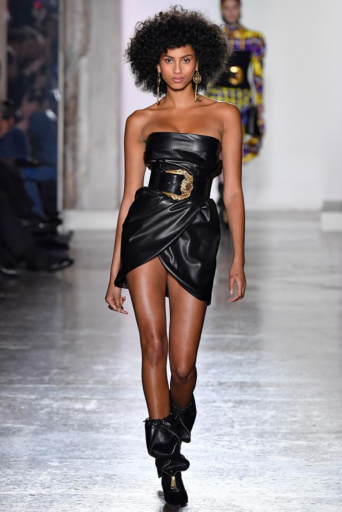 Imaan Hammam walks for Versace in Milan, 2018.