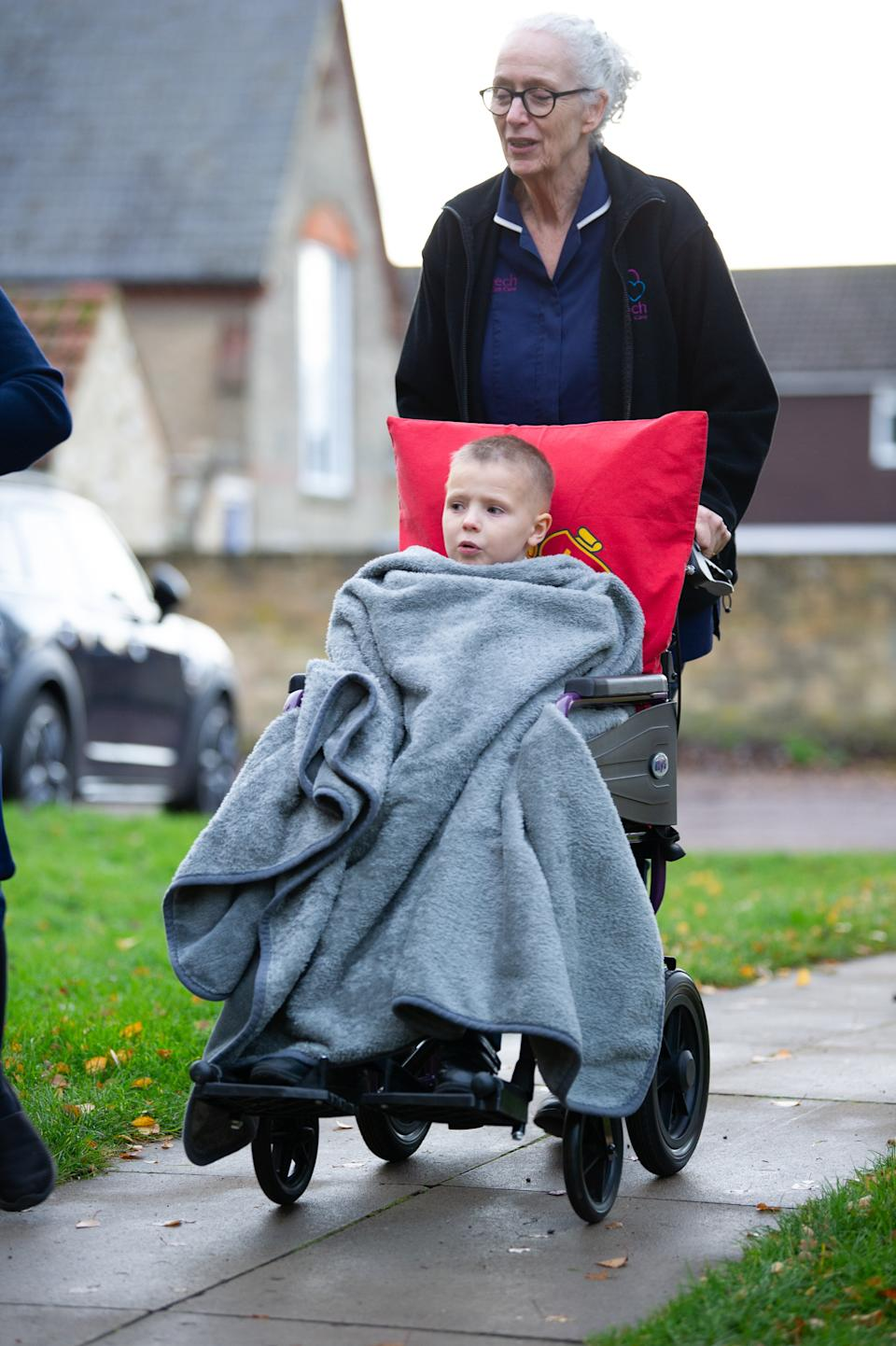 Eight year old Ethan Martin arrives at the church. [Photo: SWNS]