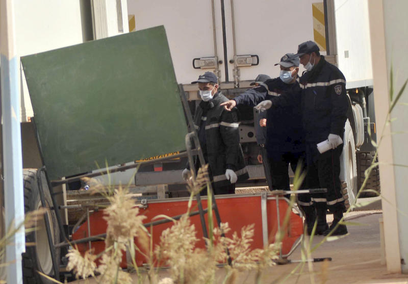 Algerian firemen prepare to unload a refrigerated truck with bodies killed during the hostage taking at a gas plant at the morgue in Ain Amenas, Algeria, Monday, Jan. 21, 2013. At least 81 people have been reported dead, including 32 Islamist militants, after a bloody, four-day hostage situation at Algeria's remote Ain Amenas natural gas plant. Nearly two dozen foreign workers remained unaccounted for late Sunday. (AP Photo/Anis Belghoul)
