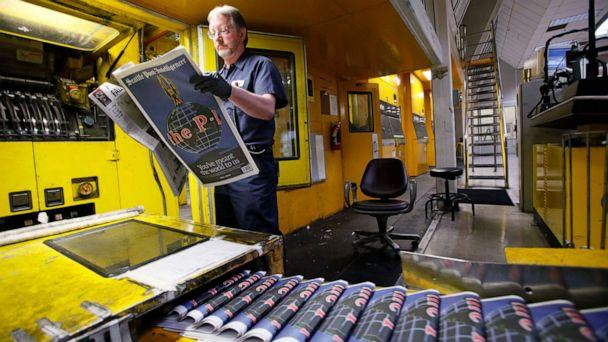 PHOTO: In this March 16, 2009, file photo, pressman Jim Herron looks over a final edition of the Seattle Post-Intelligencer as it comes off the press at the printing plant of The Seattle Times in Bothell, Wash. (Elaine Thompson/AP, FILE)