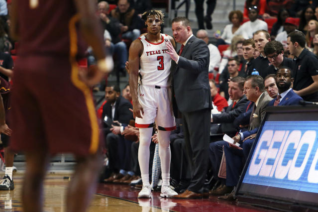 Texas Tech coach Chris Beard gives instructions to Jahmi'us Ramsey (3) during the first half of an NCAA college basketball game against Bethune-Cookman, Saturday, Nov. 9, 2019, in Lubbock, Texas. (Sam Grenadier/Lubbock Avalanche-Journal via AP)