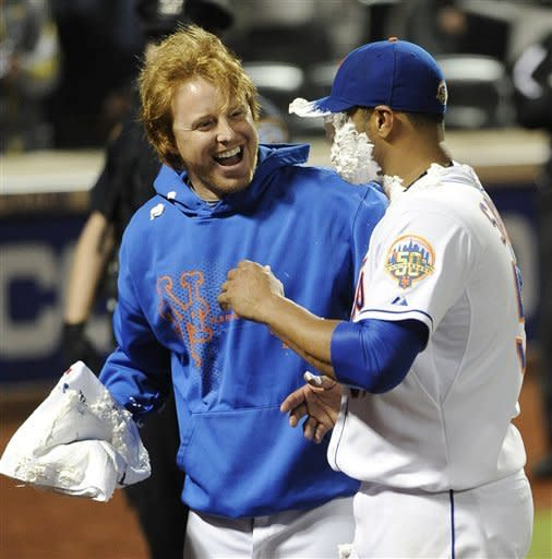 New York Mets' Justin Turner, left, reacts after hitting starting pitcher Johan Santana with a shaving cream pie after Santana threw a no-hitter against the St. Louis Cardinals in a baseball game on Friday, June 1, 2012, at Citi Field in New York. The Mets won 8-0. (AP Photo/Kathy Kmonicek)