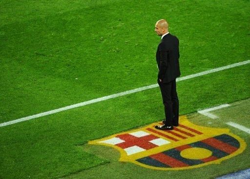 Barcelona's coach Josep Guardiola watches his team play Chelsea