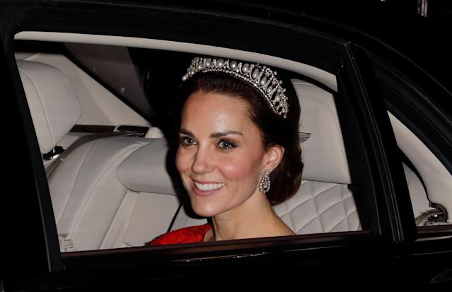 Kate wore the same tiara to the 2016 reception with a red Jenny Packham gown. (Photo: Getty Images)