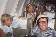 <p>The children of the Spanish royal family fill the seats of an airplane in 1973 while en route to Madrid. </p>