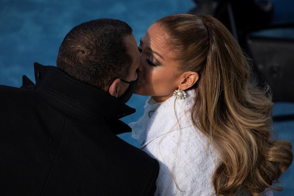 Jennifer Lopez kisses her fiance Alex Rodriguez after performing at the 59th Presidential Inauguration at the U.S. Capitol in Washington, U.S., January 20, 2021. Caroline Brehman/Pool via REUTERS