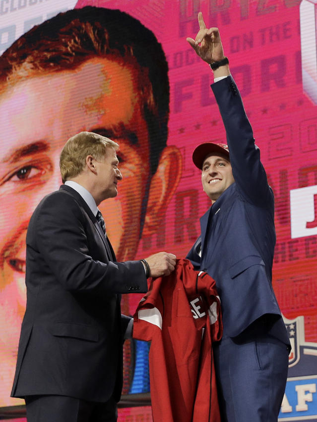 UCLA's Josh Rosen, right, gestures next to commissioner Roger Goodell after being selected by the Arizona Cardinals during the first round of the NFL football draft, Thursday, April 26, 2018, in Arlington, Texas. (AP Photo/David J. Phillip)