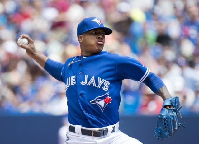Toronto Blue Jays starting pitcher Marcus Stroman works against the Boston Red Sox during first inning baseball action in Toronto on Thursday, July 24, 2014. (AP Photo/The Canadian Press, Nathan Denette)