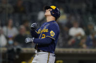 Milwaukee Brewers' Luis Urias looks skyward after hitting a home run during the third inning of a baseball game against the San Diego Padres, Monday, April 19, 2021, in San Diego. (AP Photo/Gregory Bull)