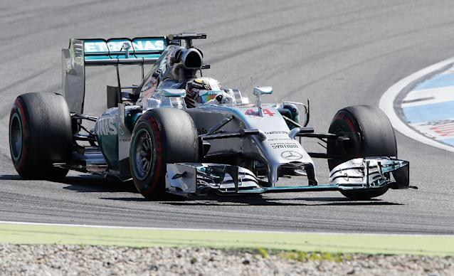 Mercedes driver Lewis Hamilton of Britain races during the third practise session of the German Formula One Grand Prix in Hockenheim, Germany, Saturday, July 19, 2014. The German Grand Prix will be held on Sunday.(AP Photo/Michael Probst)