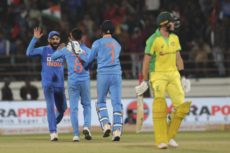 Indian cricket captain Virat Kohli, left, Ravindra Jadeja, second left, and Lokesh Rahul celebrate the dismissal of Australia's Marnus Labuschagne, right, during the second one-day international cricket match between India and Australia in Rajkot, India, Friday, Jan. 17, 2020. (AP Photo/Ajit Solanki)