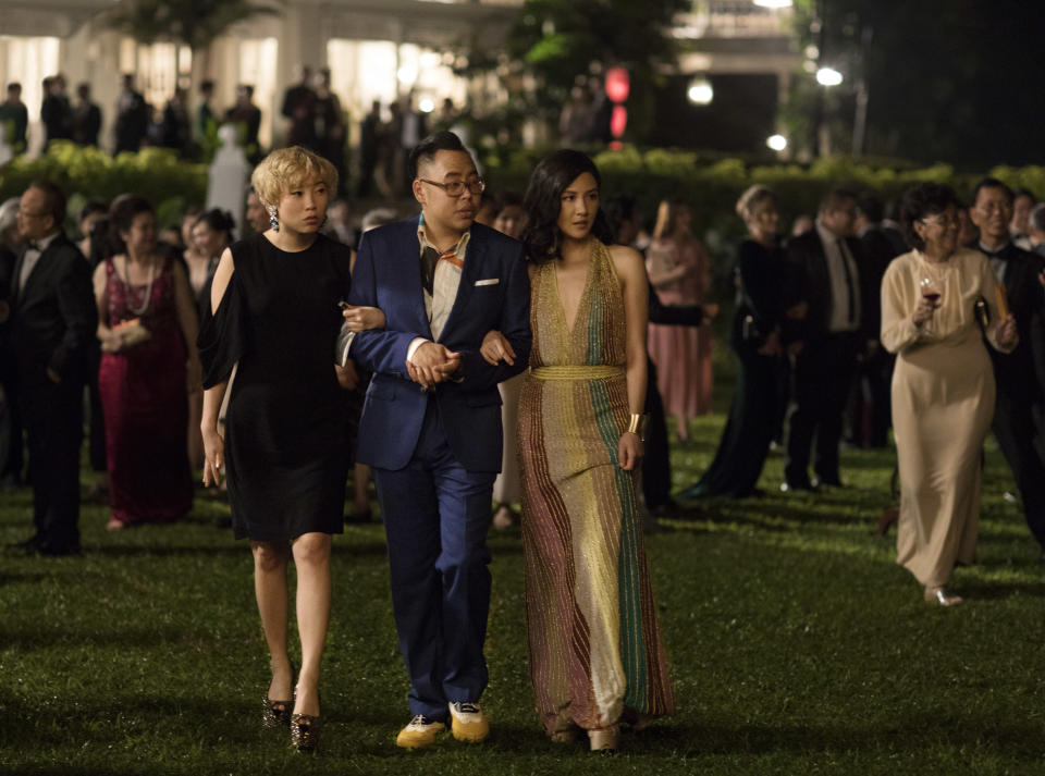 """From left: Goh Peik Lin (Awkwafina), Oliver T'sien (Nicos Santos), and Rachel Chu (Constance Wu) at Tyersall Park in """"Crazy Rich Asians"""". (PHOTO: Warner Bros)"""